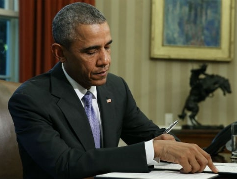 Obama signs law banding negro and oriental
